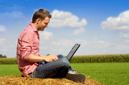 handosme man with laptop over country view.